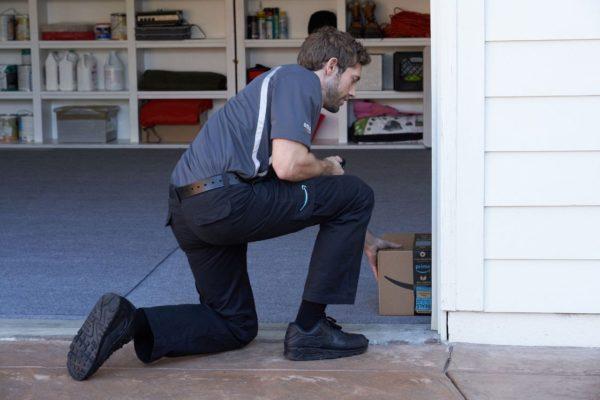 delivery man in garage   Nashville Home Inspection   smart garage Home Inspection Nashville